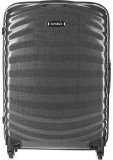 Серый пластиковый чемодан на колесах Samsonite