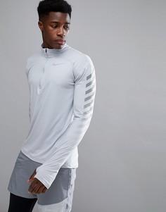 Серый свитшот с молнией 1/4 и светоотражающей отделкой Nike 859199-012 - Серый