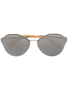 крупные солнцезащитные очки в круглой оправе Prada Eyewear