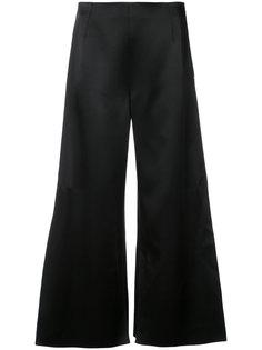 расклешенные строгие брюки  Roland Mouret