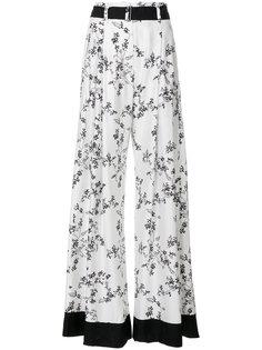 широкие брюки  с цветочным принтом  Ann Demeulemeester Blanche