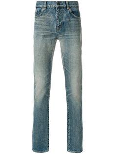 облегающие джинсы с потертой отделкой Saint Laurent
