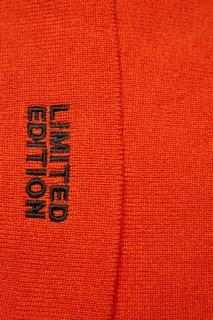 Оранжевая шапка с вышивкой Artem Krivda