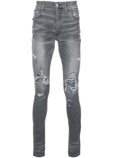 состаренные джинсы скинни  Amiri