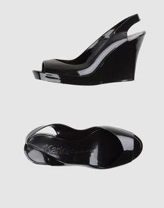 Обувь на танкетке Kartell