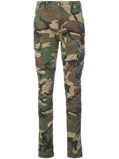 брюки скинни с камуфляжным принтом  Amiri