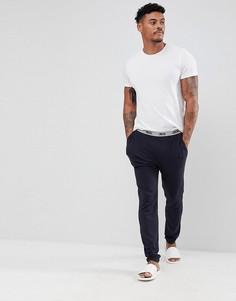 Трикотажные пижамные брюки узкого кроя с фирменным поясом ASOS - Темно-синий