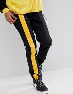 Черные джоггеры скинни с желтыми полосками ASOS - Черный