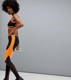Черно-оранжевые леггинсы Puma эксклюзивно для Asos - Оранжевый