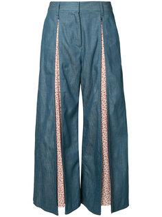 расклешенные брюки с панельным дизайном Maison Mihara Yasuhiro