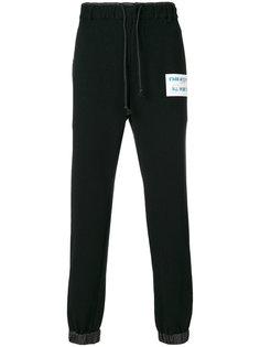 спортивные брюки с заплаткой  Sacai