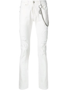 джинсы с рваным эффектом Pierre Balmain