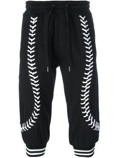 укороченные брюки со шнуровкой KTZ