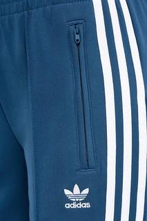 Голубые брюки с полосками Adidas