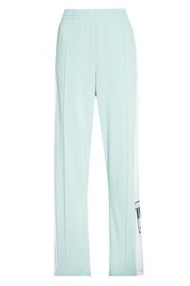 Светло-зеленые брюки с полосками Adidas