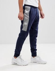 Темно-синие джоггеры скинни Nike Air 886048-452 - Темно-синий