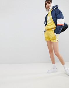 Желтые шорты с тремя полосками adidas Originals adicolor - Желтый