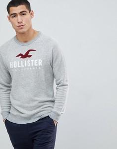 Серый меланжевый свитшот с круглым вырезом и логотипом Hollister - Серый