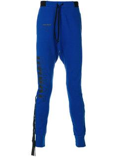 спортивные брюки с заниженной проймой Unravel Project