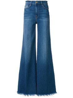 расклешенные джинсы с бахромой Frame Denim