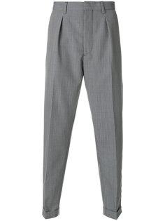 брюки в ломаную клетку Prada