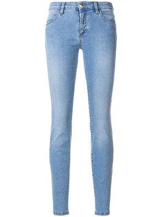 джинсы скинни с потертой отделкой Versus