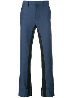 брюки с контрастными полосками Prada