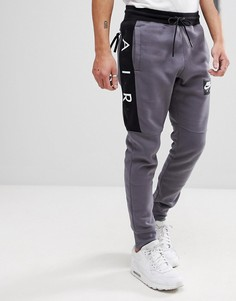 Серые джоггеры скинни Nike Air 886048-021 - Серый