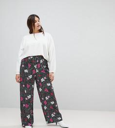 Брюки в горошек с широкими штанинами и цветочным принтом ASOS CURVE - Черный