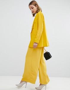 Широкие брюки со складками на талии River Island - Желтый