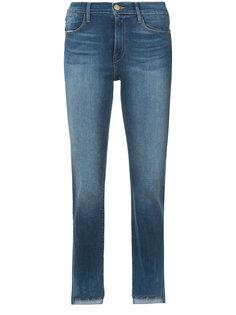 джинсы узкого кроя с асимметричным низом Frame Denim