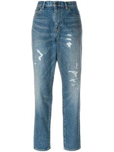 джинсы бойфренды с рваными деталями Saint Laurent
