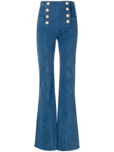 расклешенные джинсы с декоративными пуговицами Balmain