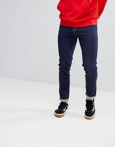 Зауженные джинсы цвета индиго с контрастной строчкой ASOS - Синий