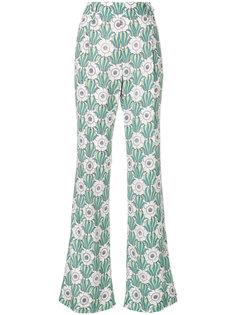 расклешенные брюки с цветочным принтом  Prada