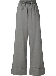 расклешенные брюки с полосками Perfect Palace Société Anonyme