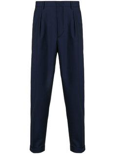 зауженные брюки Prada