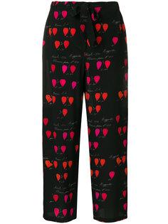 брюки с цветочным принтом  Alexander McQueen