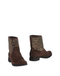 Полусапоги и высокие ботинки Solidea