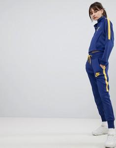 Желто-синие спортивные брюки с завышенной талией Nike - Синий