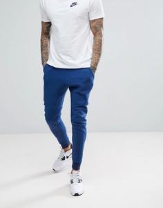 Темно-синие флисовые джоггеры скинни Nike 805162-452 - Темно-синий