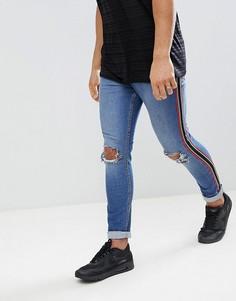 Выбеленные обтягивающие джинсы с потертостями и полосками Jaded London - Синий