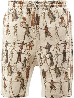 шорты с принтом танцующих скелетов Undercover