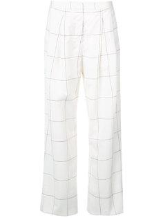 расклешенные брюки в клетку Adam Lippes