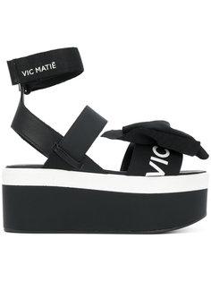 кроссовки на платформе с бантами Vic Matie