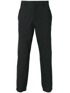брюки с полоской по бокам Prada