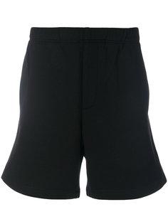 спортивные брюки с полоской по бокам Prada