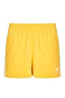 Желтые шорты с полосками Adidas
