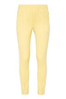 Желтые спортивные брюки SST Adidas