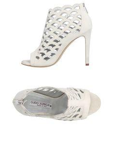 Полусапоги и высокие ботинки Guido Sgariglia